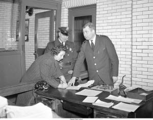 Lena Blatman, owner of Wilmington's Blatman's Bakery at the police station after being arrested for violating the blue laws.